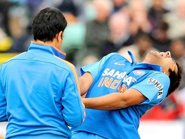 Rohit-Sharma-R-reacts-after-he-was-hit-on-the-finger-with-the-first-ball-that-he-faced-as-it-is-inspected-by-the-physiotherapist-during-the-first-one-day-international-cricket-match-against-England-at-the-Riverside-cricket-ground-in-Chester-le-Street-England