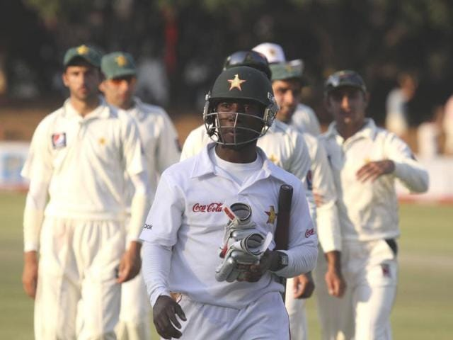 Zimbabwean-batsman-Tatenda-Taibu-walks-off-the-pitch-at-the-end-of-play-on-the-fourth-day-of-the-Test-match-against--Pakistan-at-Queens-Sports-Club-in-Bulawayo