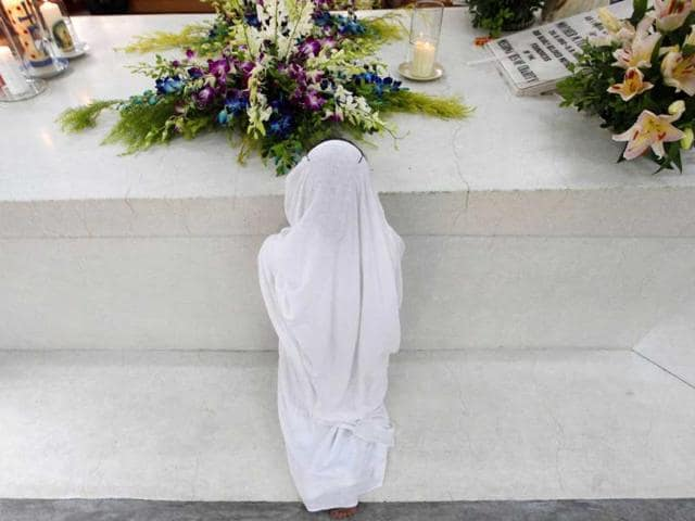 A-Catholic-nun-from-the-Missionaries-of-Charity-the-global-order-of-nuns-founded-by-Mother-Teresa-prays-at-Mother-Teresa-s-tomb-on-her-14th-death-anniversary-in-Kolkata