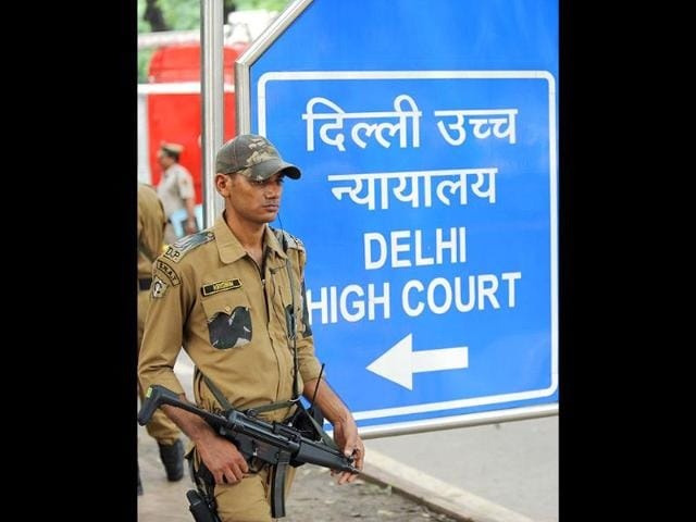 Police-commandos-stand-guard-in-front-of--Delhi-high-court-in-New-Delhi