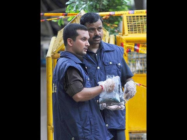 National-Investigation-Agency-officers-inspect-and-collect-evidence-from-a-deadly-bomb-blast-at-the-Delhi-high-court-in-New-Delhi