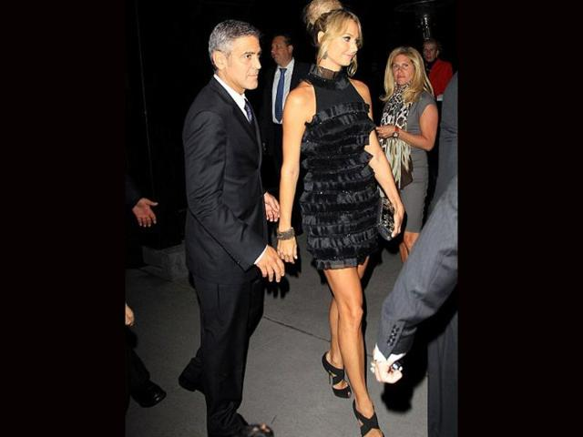 Hollywood-actor-George-Clooney-with-WWE-superstar-Stacy-Keibler-at-Toronto