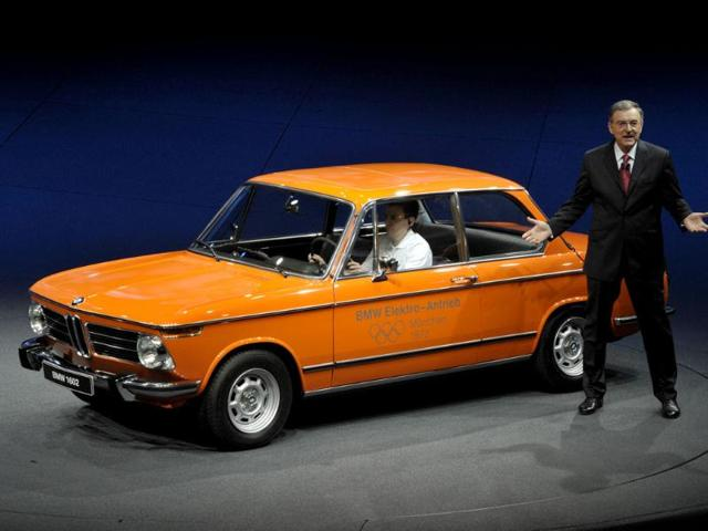 Norbert Reithofer, CEO of German luxury car maker BMW, presents one of the first BMW electric cars, a BMW 1602 from 1972 at the booth of German luxury car maker BMW at the international car show IAA (Internationale Automobil-Ausstellung) in Frankfurt.