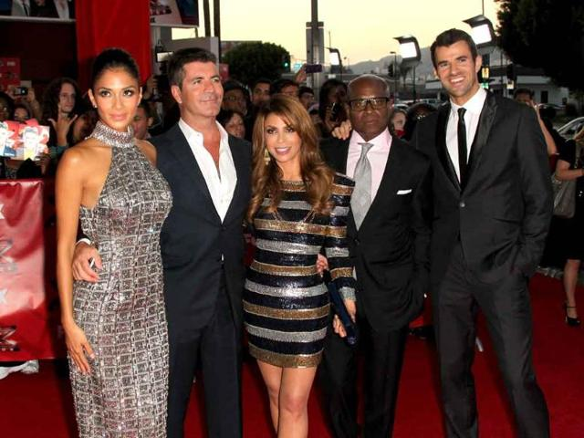 Television-show-judges-Nicole-Scherzinger-Simon-Cowell-Paula-Abdul-LA-Reid-and-show-host-Steve-Jones-arrive-at-the-premiere-Of-Fox-s-The-X-Factor-held-at-ArcLight-Cinemas-Cinerama-Dome-in-Hollywood-California