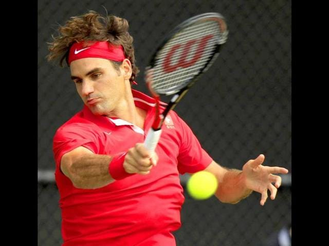 Roger-Federer-plays-a-shot-to-Lleyton-Hewitt-during-their-Davis-Cup-world-group-play-off-tennis-match-in-Sydney-Australia