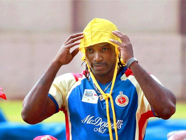 Royal-Challengers-Bangalore-player-Chris-Gayle-covers-his-head-during-a-practice-session-for-Champions-league-2011-at-National-Cricket-Academy-ground-in-Bangalore
