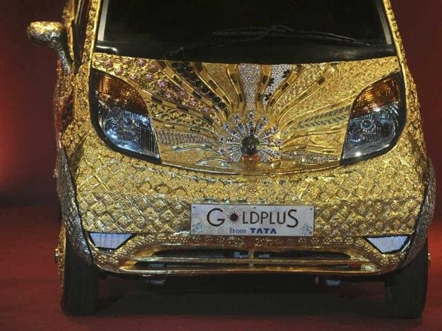 A custom Tata Motors' 'Nano' car, is seen adorned in gold, silver and gemstone trimmings during its unveiling in Mumbai. The world's first gold jewellery car, claimed by Tata, is made from 80 kilograms of 22 karat gold, 15 kilograms of silver, and numerous gemstones.
