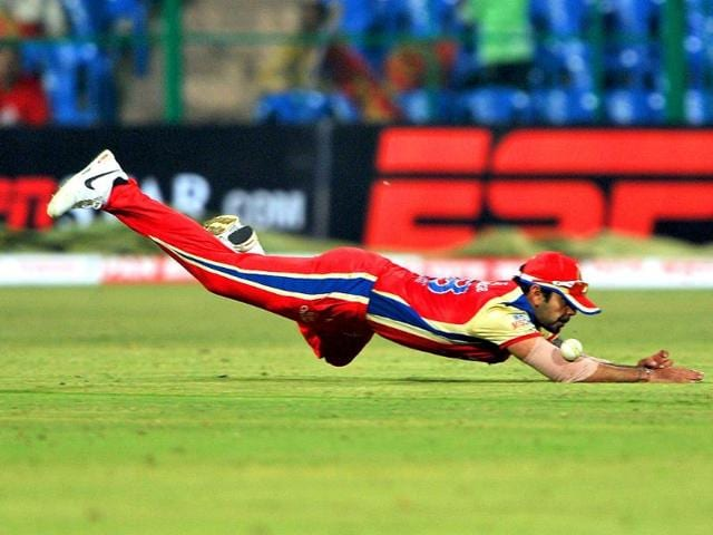 RCB-player-Virat-Kholi-dives-to-stop-a-shot--during-the-Champions-League-Twenty20-League-group-B-match-between-Royal-Challengers-Bangalore-and-Warriors-at-the-M-Chinnaswamy-Stadium-in-Bangalore