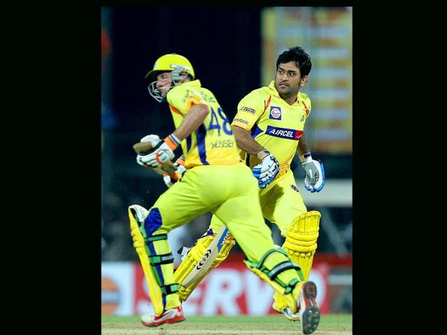 MS-Dhoni-and-M-Hussy-in-action-during-the-Champions-League-T20-2011-match-against-Mumbai-Indians-at-MAC-Stadium-in-Chennai