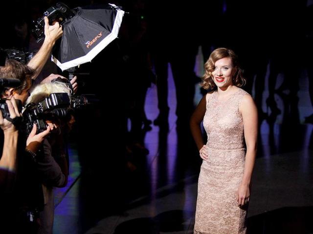 Scarlett-Johansson-smiles-as-dozens-of-photographers-queue-up-to-capture-her