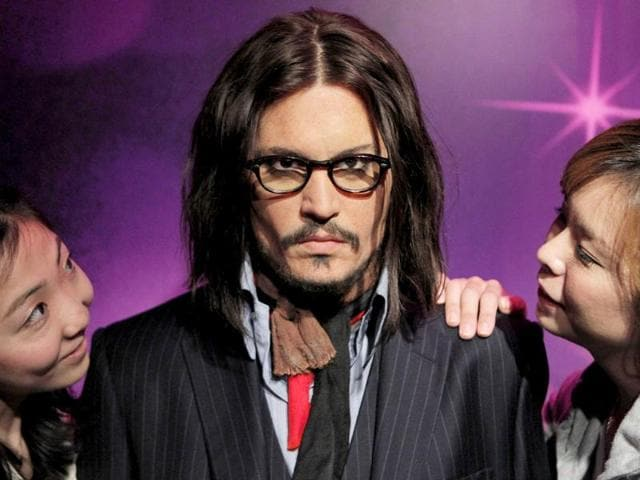 Models-pose-with-Johnny-Depp-s-wax-figure-at-the-Madame-Tussauds-wax-exhibition-in-Tokyo-Japan