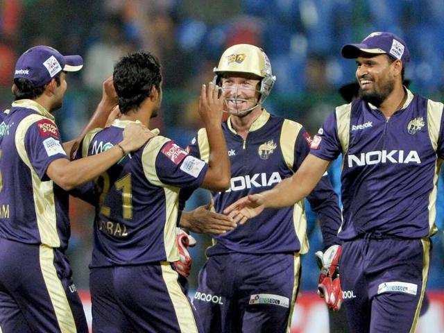 Kolkata-Knight-Riders-wicketkeeper-Brad-Haddin-2R-and-fielder-Yusuf-Pathan-R-celebrate-with-their-teammates-after-the-dismissal-of-Mayank-Agarwal-unseen-of-Royal-Challengers-during-the-Champions-League-Twenty20-League-cricket-match-between-Royal-Challengers-Bangalore-and-Kolkata-Knight-Riders-at-the-M-Chinnaswamy-Stadium-in-Bangalore