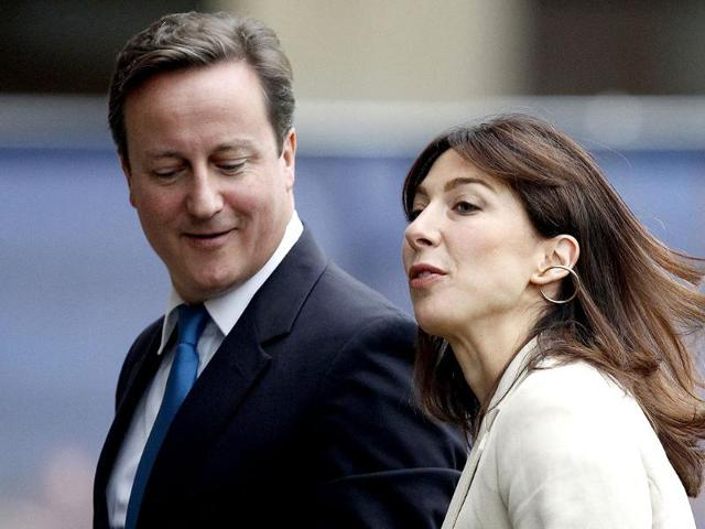 Britain-s-Prime-Minister-David-Cameron-and-his-wife-Samantha-arrive-back-at-their-hotel-on-the-first-day-of-the-Conservative-Party-s-annual-conference-in-Manchester
