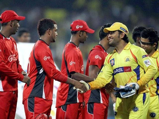 Chennai-Super-Kings-skipper-MS-Dhoni-greets-Trinidad-Tobago-players-before-their-Champions-league-T20-2011-match-in-Chennai