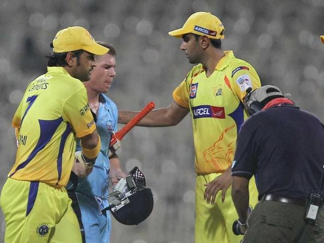 New-South-Wales-Blues-David-Warner-being-congratulated-by-Chennai-Super-Kings-skipper-MS-Dhoni-and-his-teammates-during-their-Champions-League-T20-2011-match-in-Chennai