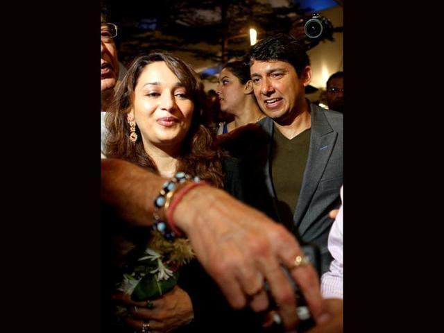 Diva-Madhuri-Dixit-with-her-husband-Sriram-Nene-at-an-event-in-Mumbai