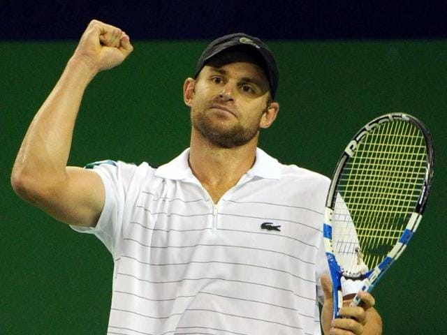 Andy-Roddick-of-the-US-celebrates-after-defeating-Grigor-Dimitrov-of-Bulgaria-during-their-second-round-match-at-the-2011-Shanghai-Rolex-Masters-tournament-Roddick-won-7-6-7-5
