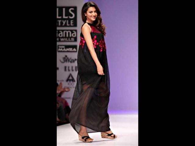 Gauhar-Khan-strikes-a-pose-in-a-chiffon-black-dress