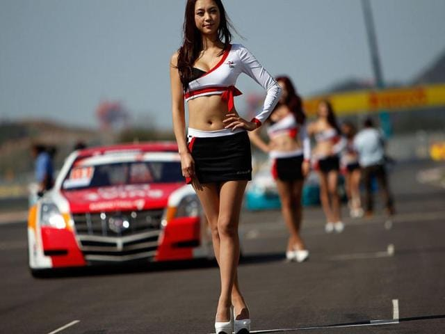 Grid-girls-of-the-South-Korean-Formula-One-Grand-Prix-pose-ahead-of-the-start-of-the-race-at-the-Korea-International-Circuit-in-Yeongam