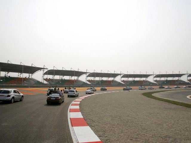 A-convoy-of-cars-drive-around-the-track-at-the-Buddh-International-Circuit-the-venue-for-the-first-ever-Indian-F1-race-at-Greater-Noida