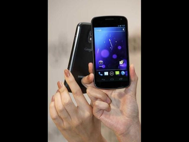 Models-display-the-new-Galaxy-Nexus-smartphone-during-a-news-conference-in-Hong-Kong-South-Korea-s-Samsung-Electronics-Co-Ltd-on-Wednesday-unveiled-its-Galaxy-Nexus-smartphone-the-first-to-use-the-latest-version-of-Google-s-Android-operating-system