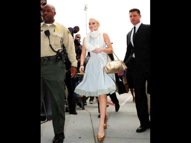 Lindsay-is-clad-in-a-white-dress