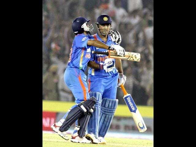 Indian-team-Captain-MS-Dhoni-and-Ravinder-Jadeja-celebrating-the-victory-after-they-won-the-third-ODI-series-between-India-Vs-England-at-PCA-Stadium-in-Mohali-by-HT-Photographer--Rajnish-Katyal