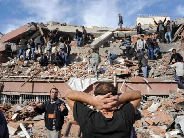 Rescue-workers-try-to-save-people-trapped-under-debris-after-an-earthquake-in-a-village-near-the-eastern-Turkish-city-of-Van-Turkey-s-Kandilli-Observatory-estimates-that-some-500-to-1-000-people-were-killed-in-a-powerful-earthquake-in-southeast-Turkey-s-Van-province-on-Sunday-broadcaster-CNN-Turk-reported