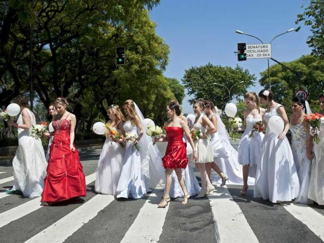 Women-wearing-bridal-dresses-take-part-in-a-bride-parade-in-Sao-Paulo-Brazil-Around-40-brides-took-part-in-the-event-organized-to-promote-family-tradition-marriage-and-maternity