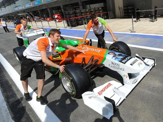 Force-India-Mercedes-pit-staff-push-a-team-car-for-inspection-one-day-before-the-practice-sessions-of-Formula-One-s-Indian-Grand-Prix-at-the-Buddh-International-circuit-in-Greater-Noida