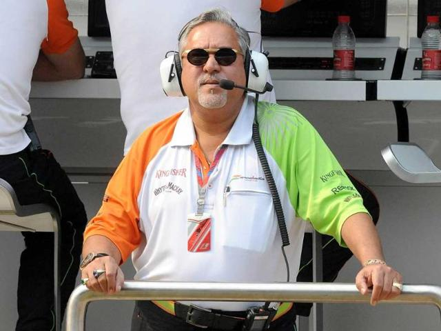 Force-India-Mercedes-Team-Principal-Vijay-Mallya-watches-the-big-screen-during-the-first-practice-session-of-Formula-One-s-Indian-Grand-Prix-at-the-Buddh-International-circuit-in-Greater-Noida