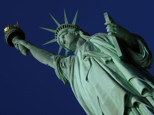 The-Statue-of-Liberty-before-the-start-of-a-ceremonies-on-Liberty-Island-in-New-York-to-commemorate-the-125th-anniversary-of-the-dedication-of-the-Statue-of-Liberty--AFP-Photo-Timothy-A-Clary