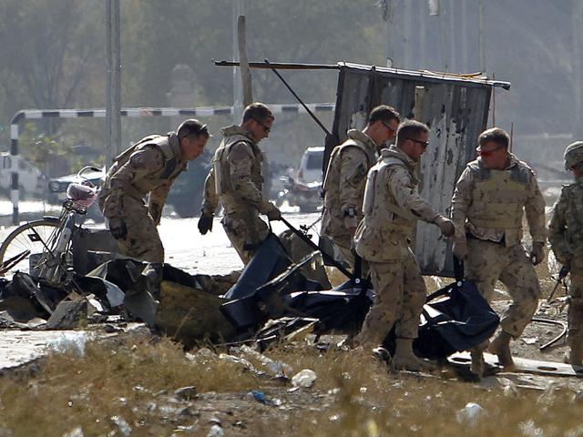 Foreign-troops-carry-a-casualty-from-the-site-of-a-suicide-attack-in-Kabul