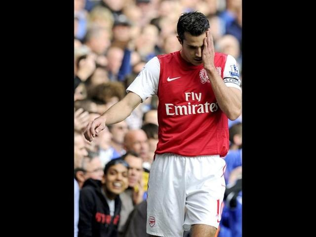Arsenal-s-Robin-van-Persie-reacts-after-missing-a-chance-to-score-during-their-English-Premier-League-soccer-match-against-Chelsea-at-the-Stamford-Bridge-Stadium-London-AP