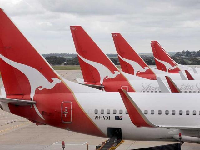Qantas-planes-await-passengers-hours-after-a-government-tribunal-ordered-an-end-to-a-destructive-industrial-dispute-that-grounded-its-fleet-and-sparked-passenger-and-political-fury-in-Melbourne