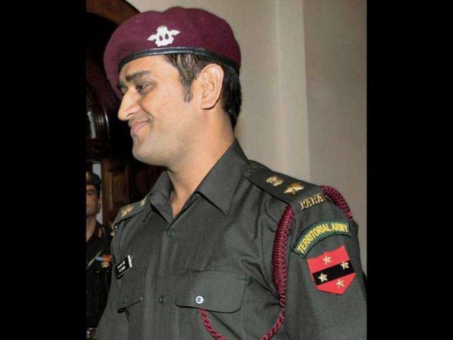 Cricket-captain-Mahendra-Singh-Dhoni-after-the-pipping-ceremony-following-grant-of-honorary-ranks-in-the-Territorial-Army--PTI-Photo