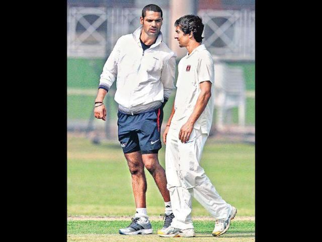 Delhi-s-Shikhar-Dhawan-and-Mithun-Manhas-plan-the-course-of-action-against-Haryana-during-a-training-session-at-the-Roshanara-Club-on-Wednesday-HT-Photo-by-Sanjeev-Verma