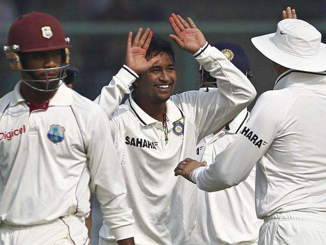 Pragyan-Ojha-C-celebrates-with-his-team-mates-after-dismissing-West-Indies-Kieran-Powell-L-during-the-first-day-of-their-first-Test-cricket-match-in-New-Delhi