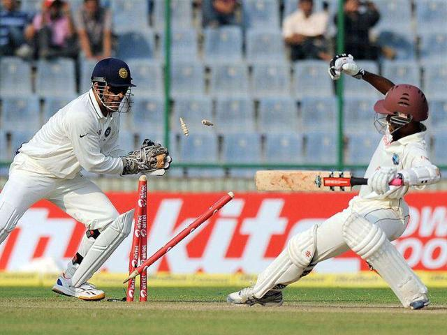 Mahendra-Singh-Dhoni-stumps-West-Indies-Kraigg-Brathwaite-during-the-first-day-of-the-first-Test-match-at-the-Feroze-Shah-Kotla-Stadium-in-New-Delhi-AFP-Prakash-Singh