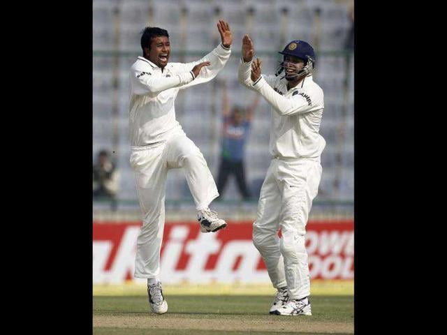 India-s-Pragyan-Ojha-L-celebrates-with-his-team-mate-VVS-Laxman-after-dismissing-West-Indies-captain-Darren-Sammy-during-the-second-day-of-their-first-test-cricket-match-in-New-Delhi