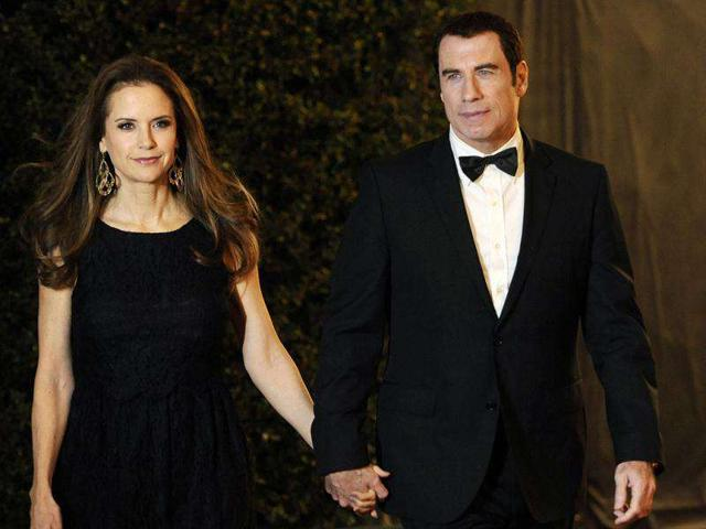 John-Travolta-right-and-his-wife-Kelly-Preston-arrive-at-the-Academy-of-Motion-Picture-Arts-and-Sciences-2011-Governors-Awards-AP-Photo-Chris-Pizzello