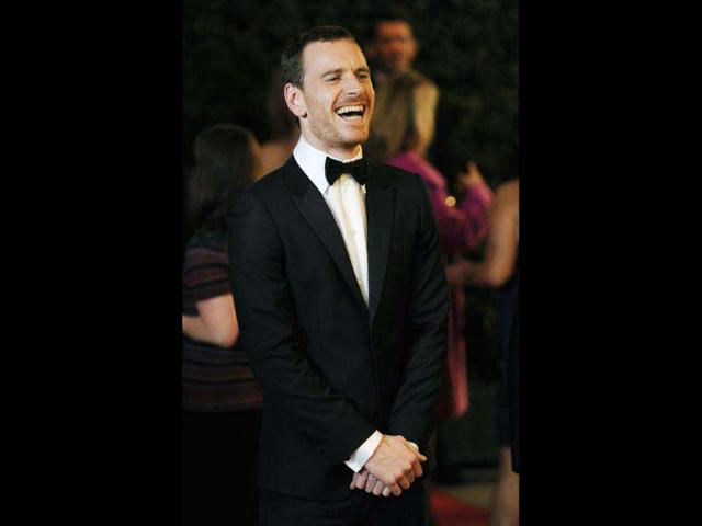 Actor-Michael-Fassbender-reacts-to-photographers-at-the-Academy-of-Motion-Picture-Arts-and-Sciences-2011-Governors-Awards-AP-Photo-Chris-Pizzello