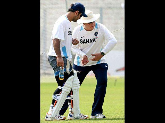Indian-Captain-MS-Dhoni-gets-tips-from-coach-Duncan-Fletcher-during-their-training-session-at-Eden-Garden-in-Kolkata-on-the-eve-of-2nd-Test-match-against-West-Indies