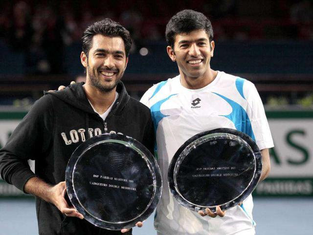 Pakistani-Aisam-Ui-Haq-Qureshi-and-teammate-Rohan-Bopanna-pose-with-their-trophies-after-winning-their-double-final-against-French-Nicolas-Mahut-and-French-Julien-Benneteau-during-the-Paris-Tennis-Masters-Series-indoor-tournament-AFP-Jacques-Demarthon