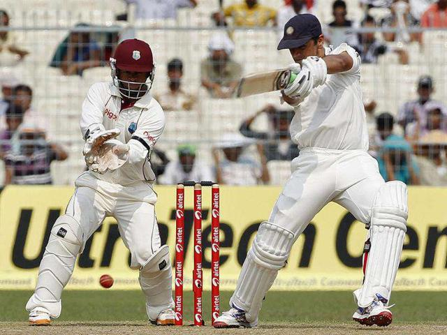 Rahul-Dravid-R-plays-a-shot-as-West-Indies-wicketkeeper-Carlton-Baugh-watches-on-the-first-day-of-their-second-Test-cricket-match-in-Kolkata