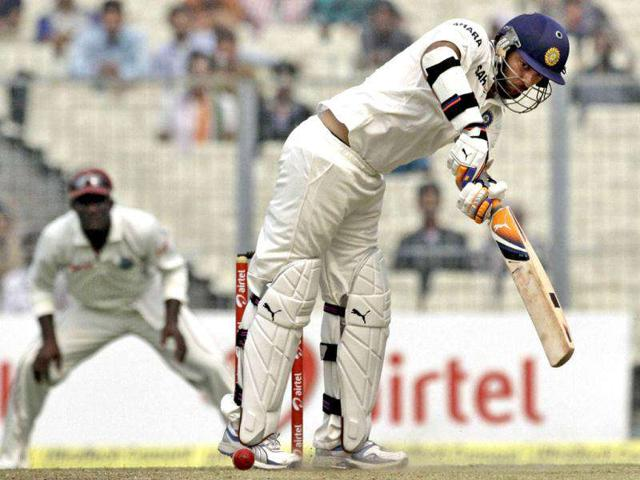 Yuvraj-Singh-plays-a-ball-during-the-second-day-of-second-cricket-Test-match-against-West-Indies-in-Kolkata