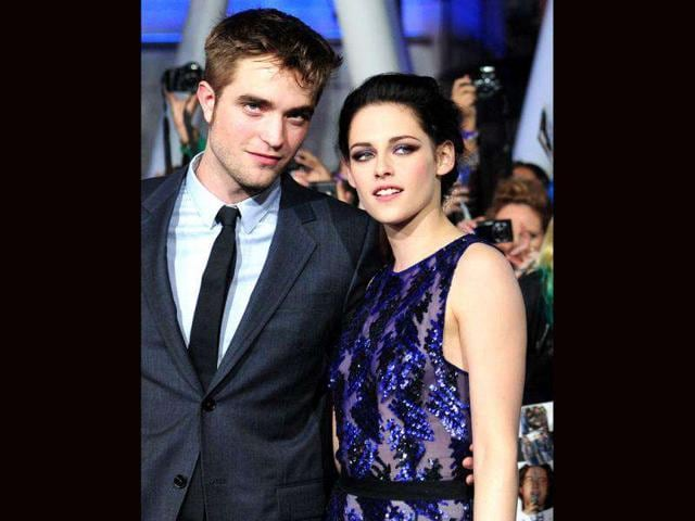 Robert-Pattinson-left-and-Kristen-Stewart-strike-a-pose-for-lensmen-at-the-world-premiere-of-The-Twilight-Saga-Breaking-Dawn-Part-1-AP-Photo-Matt-Sayles