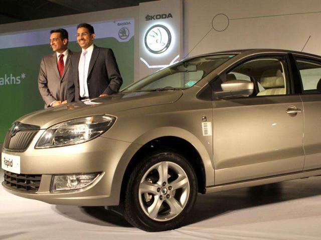 Skoda Auto India Marketing Head Tarun JhaTarun Jha (R) and Associate Director Sales Ashutosh Dixit (L) pose with the newly unveiled Skoda Rapid in New Delhi. HT Photo/Virendra Singh Gosain