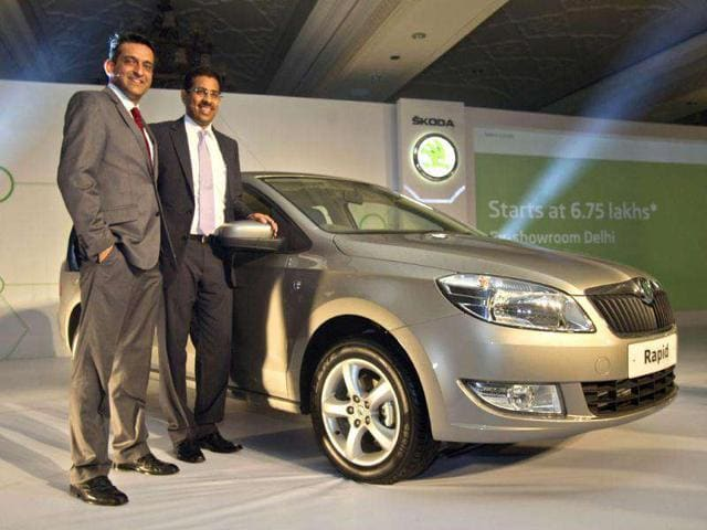 Skoda Auto India Marketing Head Tarun Jha, left, and Associate Director Sales and Marketing Ashutosh Dixit pose with the newly launched Skoda Rapid car in New Delhi. The Rapid has a 1.6 liter engine in petrol and diesel variants with a starting price of Rs 6,75,000 (US $13,235). AP Photo/Gurinder Osan