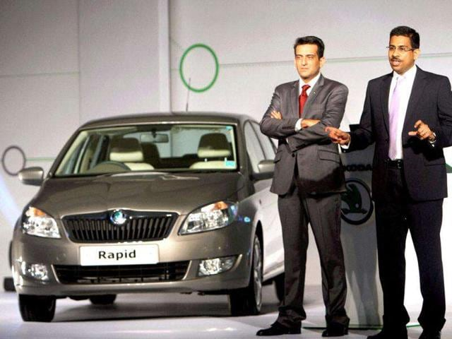 Ashutosh Dixit, General Manager (Sales and Marketing), Skoda (R) with Marketing Chief Tarun Jha at the launch of the company's new car Rapid in New Delhi. PTI Photo by Subhav Shukla